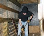 Brad shoveling wood chips